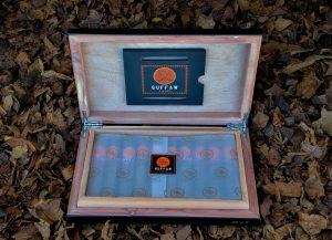Guffaw Cigars come in a portable humidor box